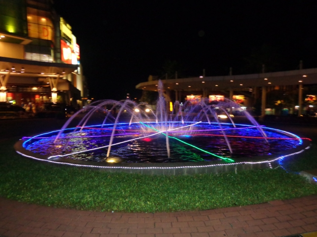 A fountain outside of the outside mall.