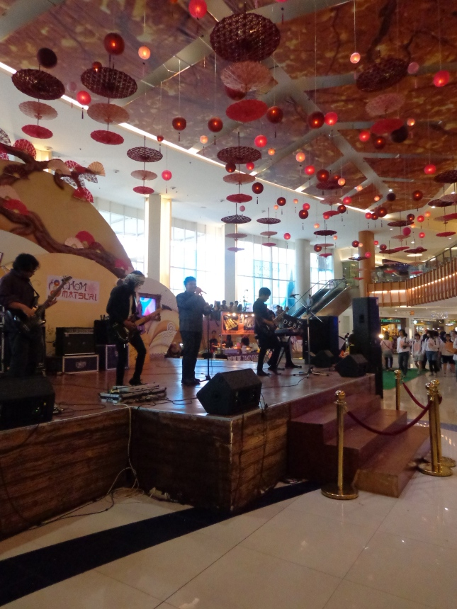 A band playing at the local mall